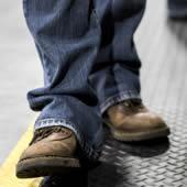 Boots walking on flooring